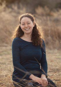 portrait of Chantal outside in a field